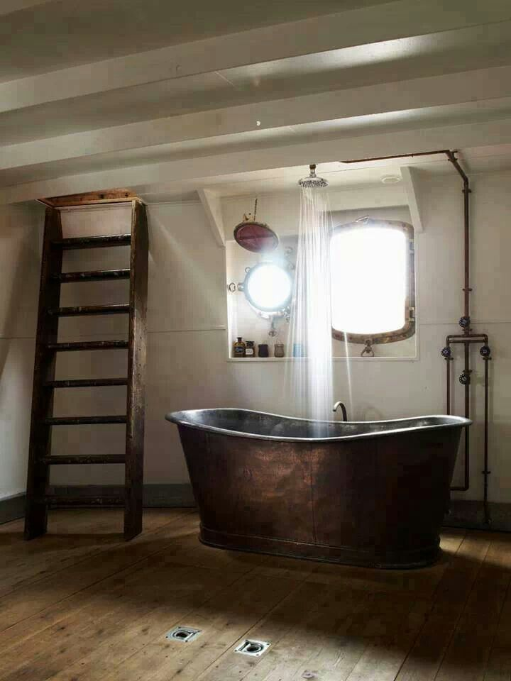 CheviotProducts likes all of the rustic decor which accompanies this cast iron tub.  OMG, this would be the perfect marriage of my love of baths with my family's love of showers in the same stylish accessory
