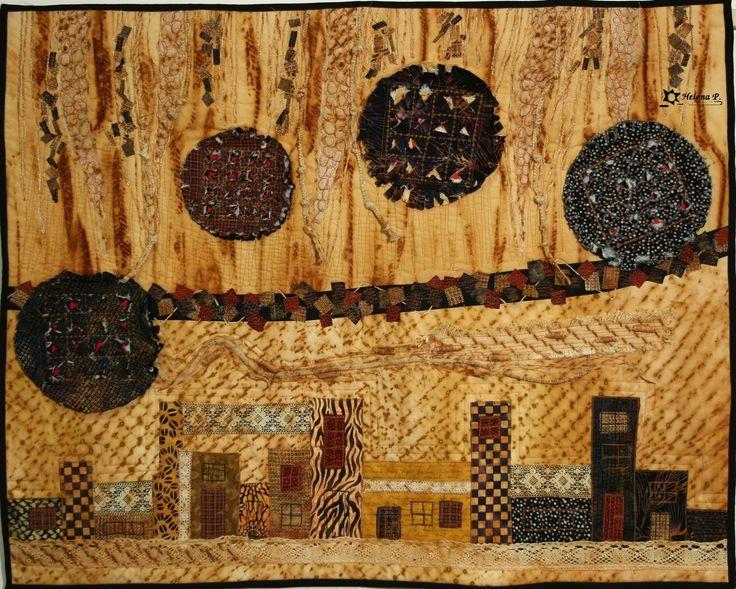 Jiné světy nad námi - textilní obraz Textilní obraz šitý technikou patchwork a art quilt a zdobený volným quiltováním. V zadní části všit tunýlek na provlečení tyčky. Obraz byl vystaven na Bohemia Patchwork meeting v Praze 2010 , naFestival of Quilts 2010 v Birminghamu a v lednu 2011 ve Vídni. Velikost 99cm x 60 cm.