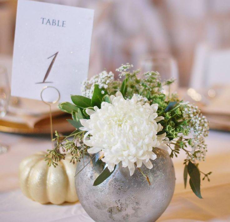 Wedding centerpiece silver mercury dish white football