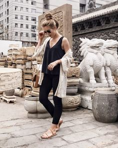 Cute casual outfit. Love the all black with the light colored cardigan. And then the messy bun? Perfect!
