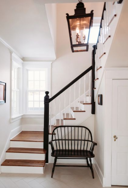 Black hand rail, stained treads, painted risers