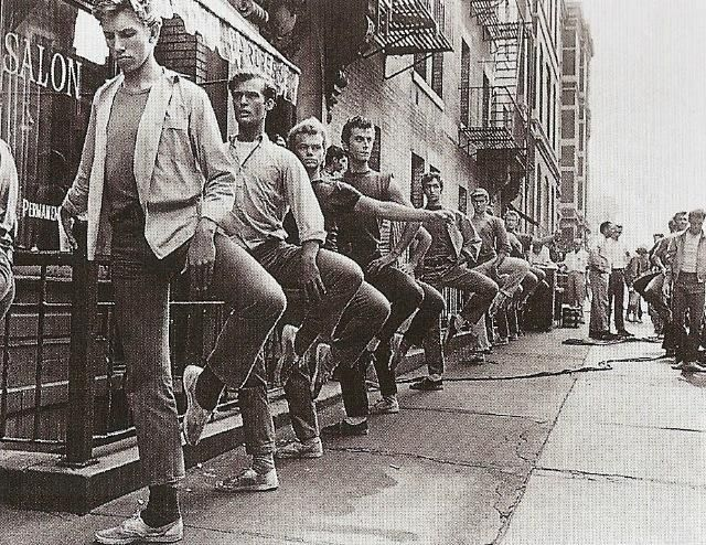1961, on the movie set of the West Side Story. Male actors (dancers) taking ballet class on the side.