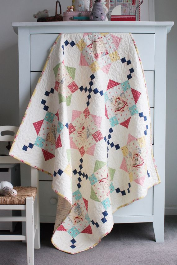 """""""Rooftops"""" Quilt featuring Bon Bon Bebe Fabrics by Robyn Pandolph ~ Designed by Amy from nanacompany ~ FREE pattern download!"""