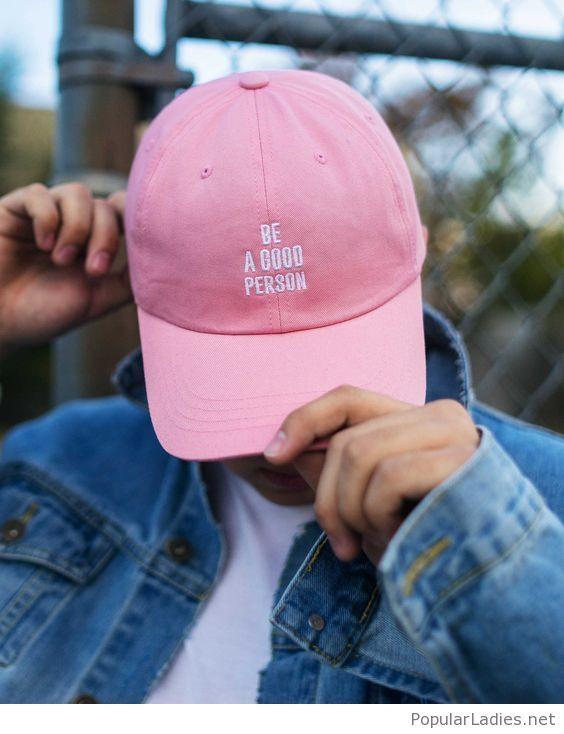 White tee, denim jacket and pink cap