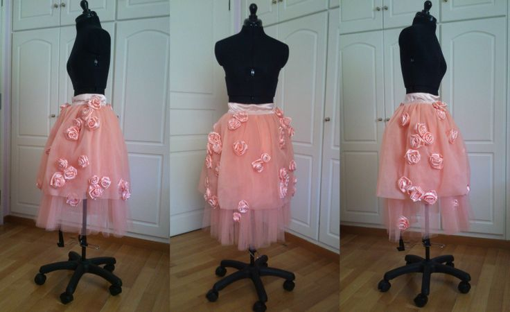 Two-layer pink tulle skirt with handmade roses sewn on it.