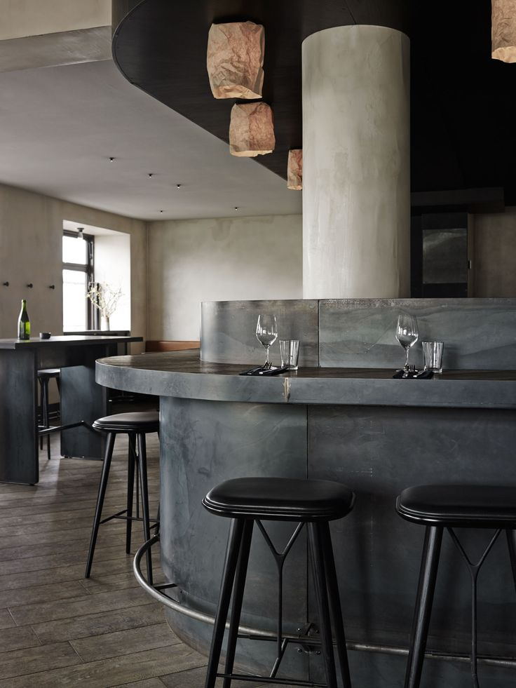 Musling Restaurant in Copenhagen, Denmark by Space Copenhagen | Yellowtrace. Washed concrete, tan leather, black timber. simple natural colours