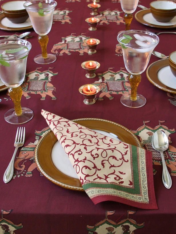 Springtime Tablescape / tablesetting / Elephants Everywhere    The rich purple and gold accents of this exotic tablecloth from Saffron Marigold make for a festive feast.: Gold Accent