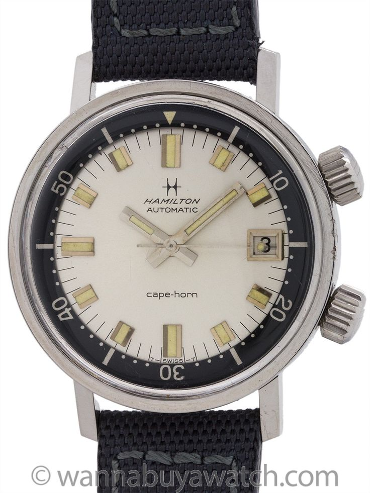 "Hamilton Super Compressor ref# 64040-3 Diver's circa 1960's - Hamilton ""Cape Horn"" dual crown super compressor diver's model circa 1960's with 600 meters depth rating. Featuring a 36mm diameter case with screw down caseback and outer black rotating elapsed time bezel controlled by 2nd crown at 2 o'clock. Featuring a beautiful, professionally refinished cream dial with applied indexes with aged luminous and matching aged luminous match stick style hands. Powered by self winding caliber 64A…"