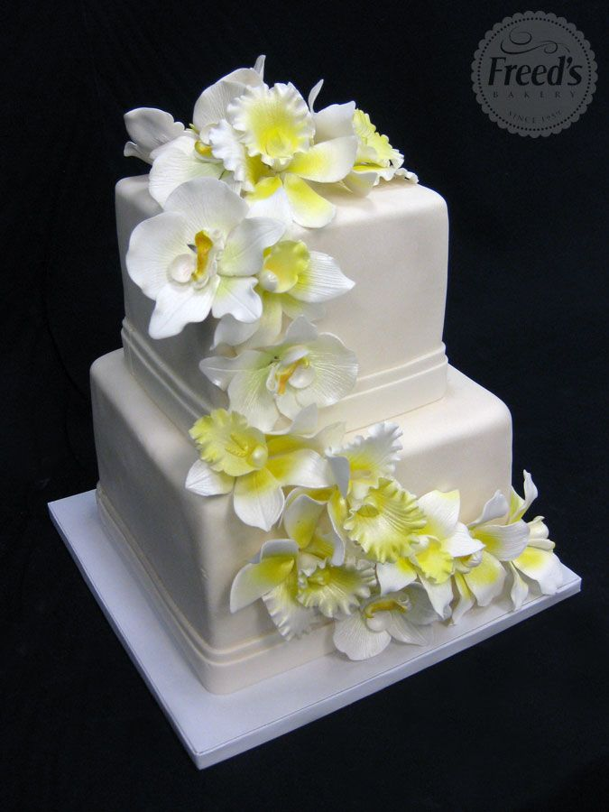White square cake with sugar pasted orchid mix with pearl shimmer.