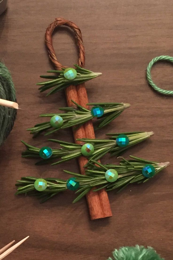 Cinnamon Stick Christmas Tree Ornaments - use graduated popsicle stick pieces instead of rosemary.