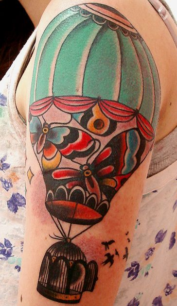 I'd like to incorporate a hot air balloon into a tattoo for my left arm. I like the placement of this one.