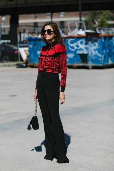 What's black, white (kind of?) and red all over? This street style chick; she's wearing a Versace top, oversized sunnies ,and high-waisted trousers.