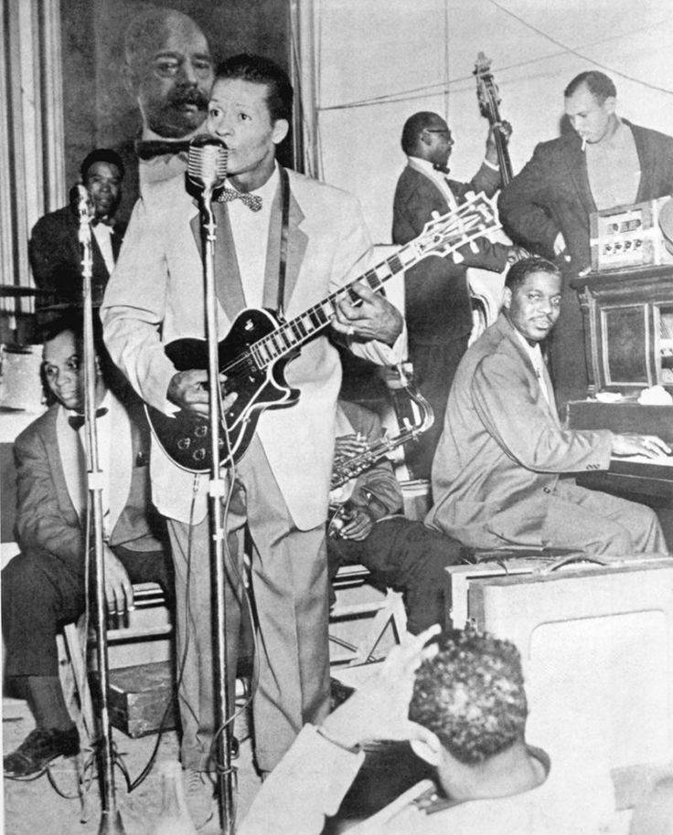 Rock and roll musician Chuck Berry plays a Gibson Les Paul electric guitar as he performs onstage with his band including piano player Johnnie Johnson in circa 1957. (Photo by Michael Ochs Archives/Getty Images)