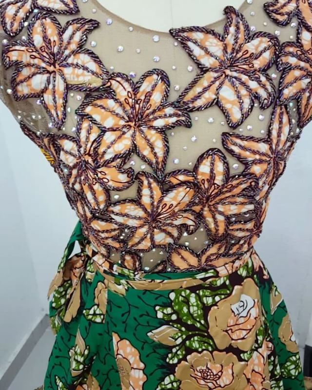 The details on my ankara outfit for the thisday style cover shoot.. I cut out patterns from the ankara, beaded it out, placed it on a tulle top and stoned it..... #kathyanthonydesigns #skirtandblouse #kathyanthony
