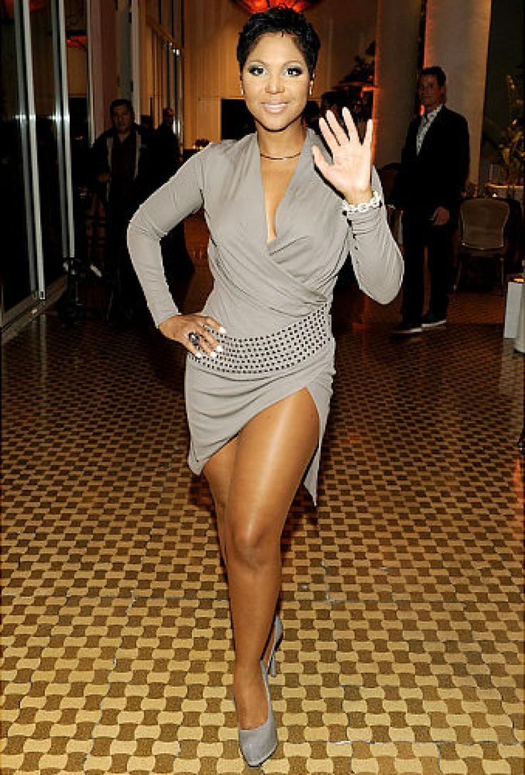 ... and Toni Braxton pulls out all the stops - and the fabric - at a pre-Grammys bash.