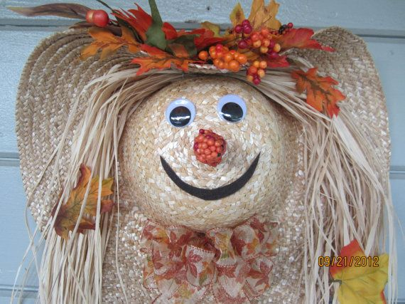 Fall Harvest Scarecrow Door Decoration. This is kinda cute. For sale on etsy. Made from 18 inch stray hat.