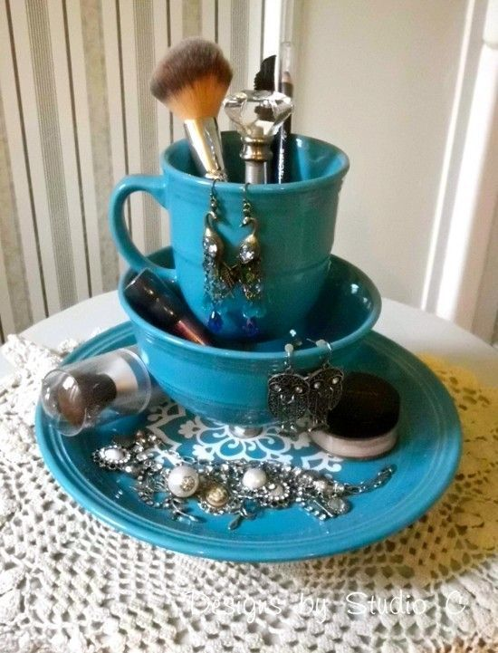 Spray paint old dishes to match your room and stack them up. Display your favorite jewelry and makeup along the sides. Find this idea on Pinterest.   - Seventeen.com
