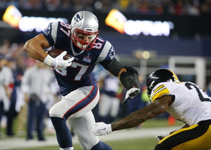 New England Patriots tight end Rob Gronkowski (87) shakes off Pittsburgh Steelers safety Robert Golden (21) as he heads for a touchdown after catching a pass in the first half of an NFL football game, Thursday, Sept. 10, 2015, in Foxborough, Mass. (AP Photo/Winslow Townson)