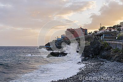 Resort hotels by a rocky beach in Canico de Baixo, Madeira, Portugal . Hotels Oasis Atlantic at sunset.