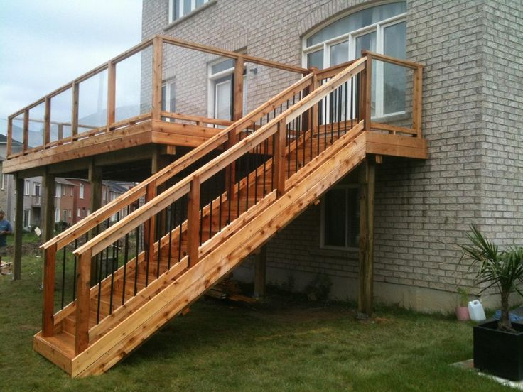 Second Story Cedar Deck And Stairs With Glass Railing