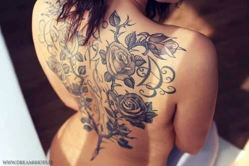 Amazing Black Roses With Leaves Tattoo On Girl Full Back