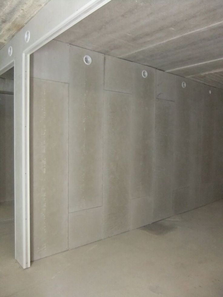 Underground car space closed with our insulated wall panels. This installation makes  area becoming a garage. Panels are made to eliminate humidity, mould or dampness and in the same time insulates the room. Several features in one wall panel.