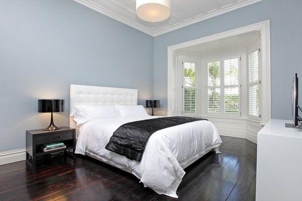 Resene Milk White & Porcelain on the skirtings and accents.  Resene Smalt Blue on the walls.