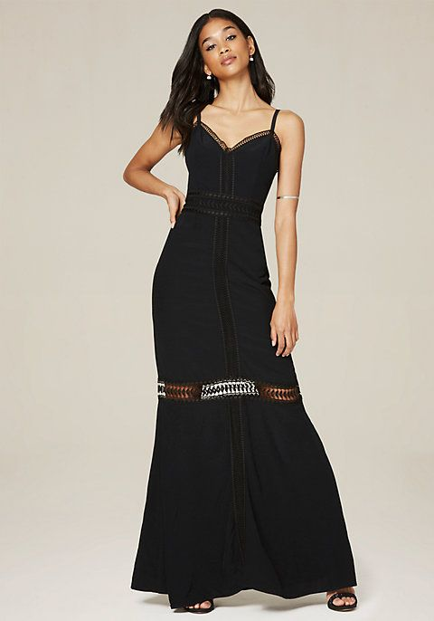 Dreamy maxi dress detailed with lace and threadwork. Strappy design shows off skin. Hidden back hook-and-eye and zip closure. Lined to mid-thigh.