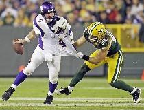 Minnesota quarterback Brett Favre is pressured by Clay Matthews in 2010 at Lambeau Field
