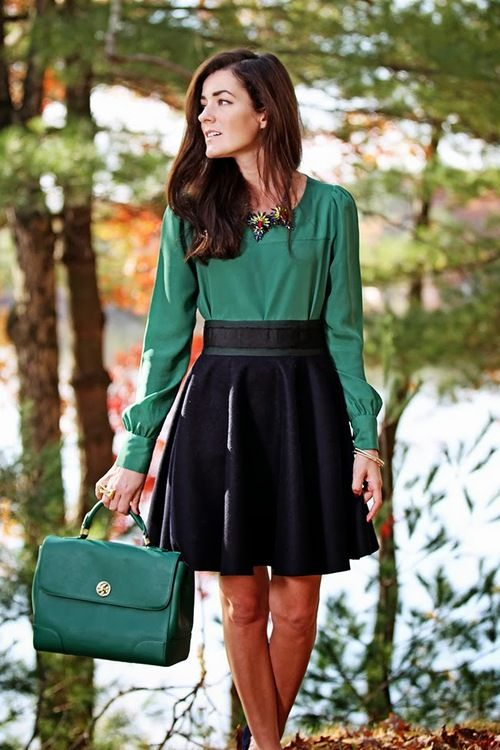 black a-line skirt with green blouse and matching green bag