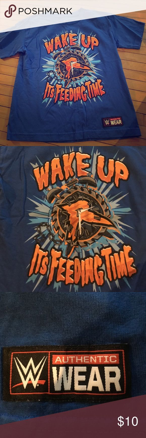 Youth size W Authentic Wear size M. 8/10 Boys size 8/10. Medium youth size. Authentic wear. Wake up it's feeding time. Feed me more. WWE Shirts & Tops