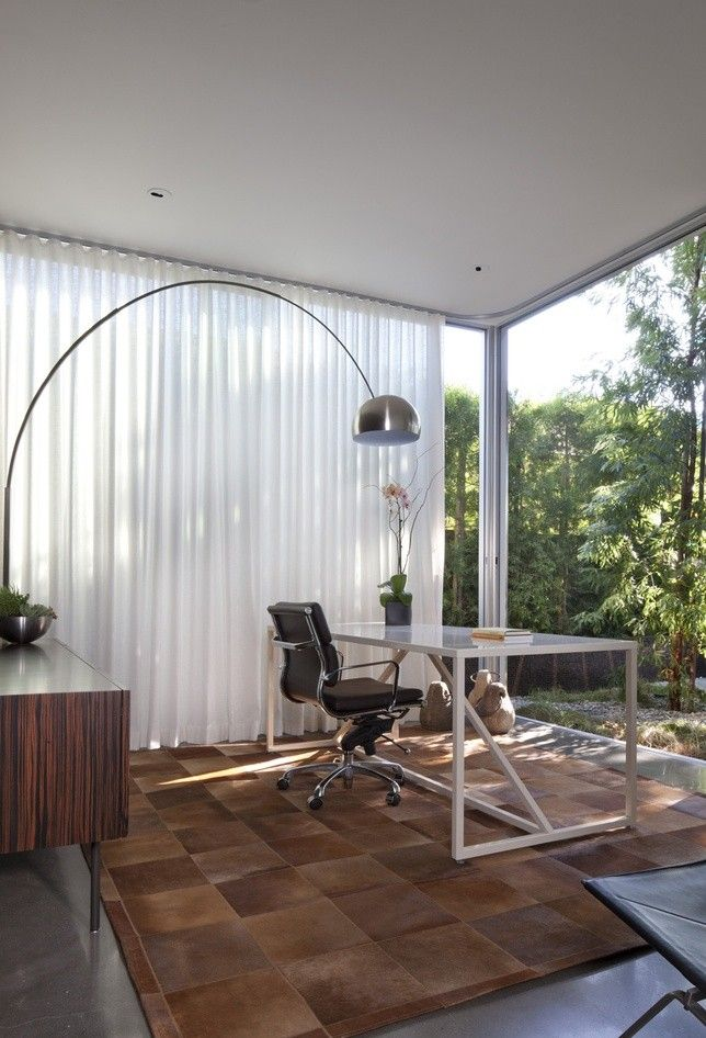 Full height sheer white curtains in home office by Modal Design, Remodelista