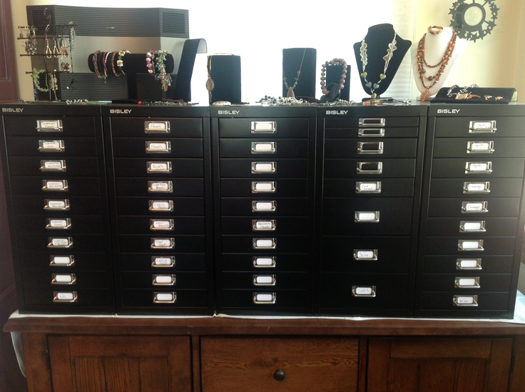 """After looking all over for storage units for my jewelry making supplies, I ended up with these Bisley cabinets on a buffet cabinet.  I love it.  I have more than enough space for all my beads, my wire, patterns, everything.  Bought the cabinets at """"The Container Store""""."""