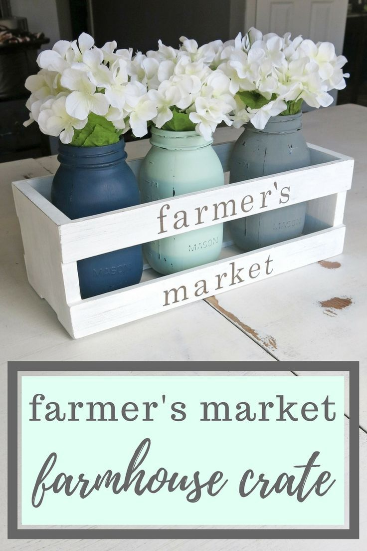 Farmer's Market Farmhouse Crate Centerpiece | Spring Farmhouse Wooden Crate | Farmhouse Style Crate | Fixer Upper Style Spring Decor | Painted Mason Jars with White Hydrangeas in Wood Crate | Wooden Crate with Farmer's Market on it | White distressed crat