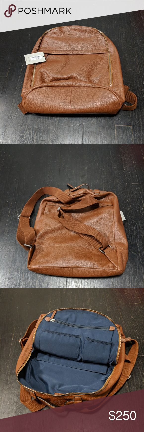 """Cole Haan Women's Barrington Backpack (Taken directly from the Cole Haan website)- Classic pebble leather gets a distinctly modern update with industrial details such as exposed zippers, lobster clasps, and webbing straps. Ideal for commuting and even weekends away, it's roomy enough for a """"15 to """"17 laptop or a tablet and gym clothes. A front pocket offers easy access, while adjustable straps and inside zip pockets make this bag both organized and user-friendly.   - 12"""" L x 18 H x 5"""" D…"""