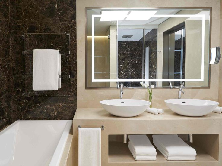 The Art Suite bathroom with non misting mirrors and chromo lighting. #excelsiorgallia #suites #theluxurycollection