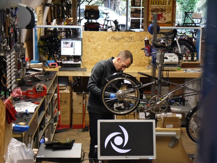 The mechanic hard at work on a TSR Moulton fitting it with a Rohloff gearing system.