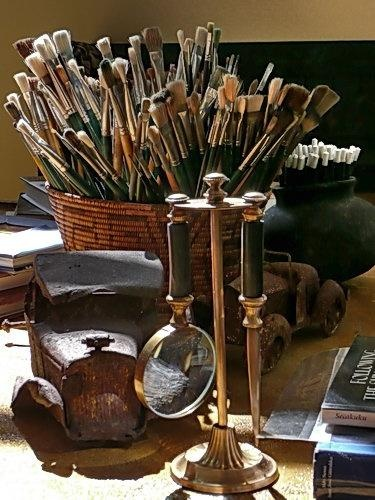 Artist brushes.  I love the magnifying glass and letter opener in the holder.