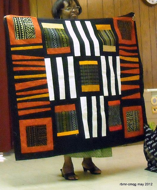 Chicago Modern Quilt Guild May 2012 New member Reneau's made with cloth from Africa when she lived there.
