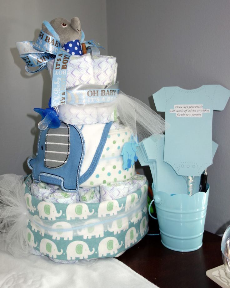 From my baby shower: diaper cake and elephant rattle. All of the guests wrote a message of advice for me on a blue paper shaped as a onesie. It was fun to read those kind messages after the baby shower and  again before his first birthday. I still have those notes saved - a great momento and keepsake for the mother and father-to-be.