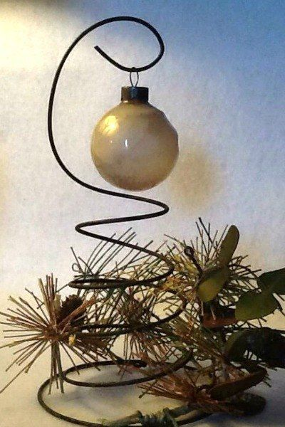 s from your community 10 inexpensive shortcuts to a better holiday home, home decor, home improvement, repurposing upcycling, Display your best ornaments using bedsprings