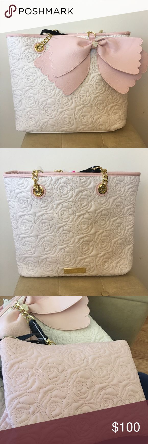 Betsey Johnson blush and cream / off white purse Betsey Johnson blush and cream / off white purse. Cute bow. NWT. Includes second bag - removable ouch with wristlet strap! Super cute and feminine. Perfect for spring! Betsey Johnson Bags