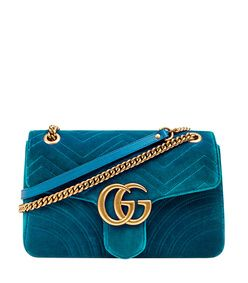 A teal velvet purse will elevate any outfit.