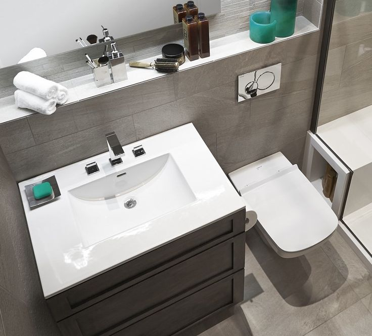 A single-sink vanity, Duravit© toilet and built-in storage make the most of limited bathroom space.