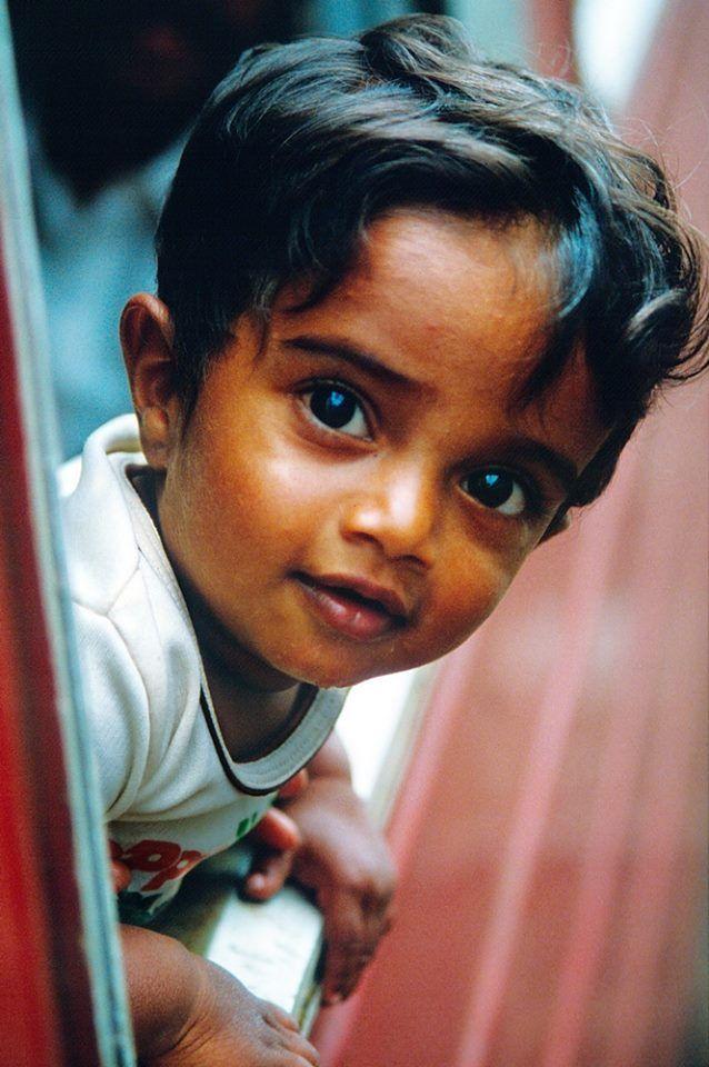 Sri Lankan boy. He's gonna break a lot of hearts when he grows up. . .breaking mine right now.