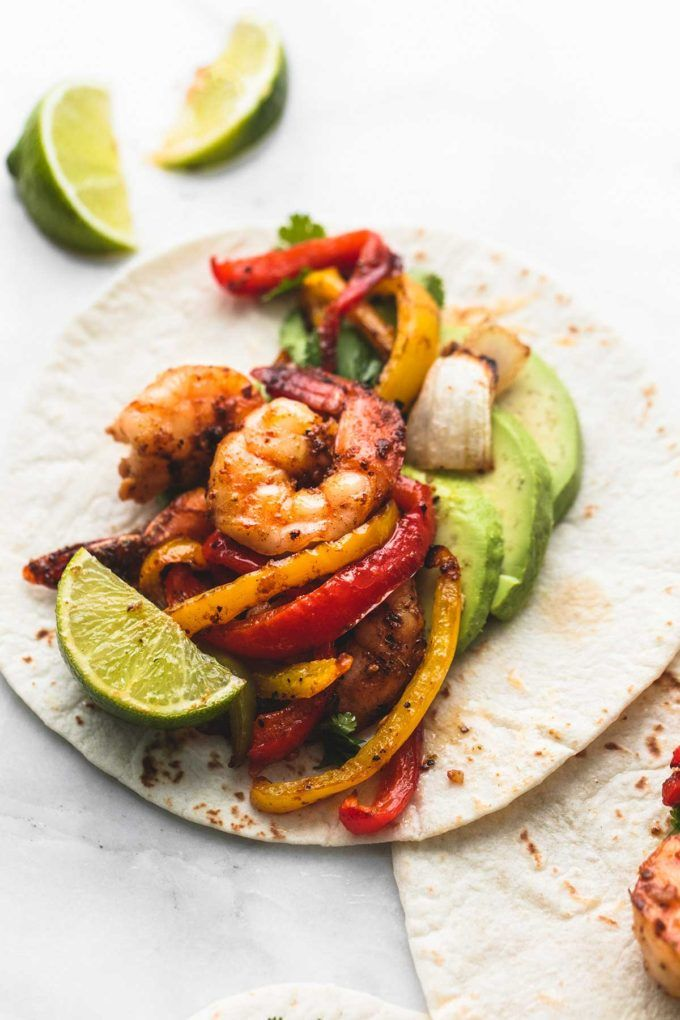 One pan easy and healthy Sheet Pan Chili Lime Shrimp Fajitas are ready in just 20 minutes! | lecremedelacrumb.com
