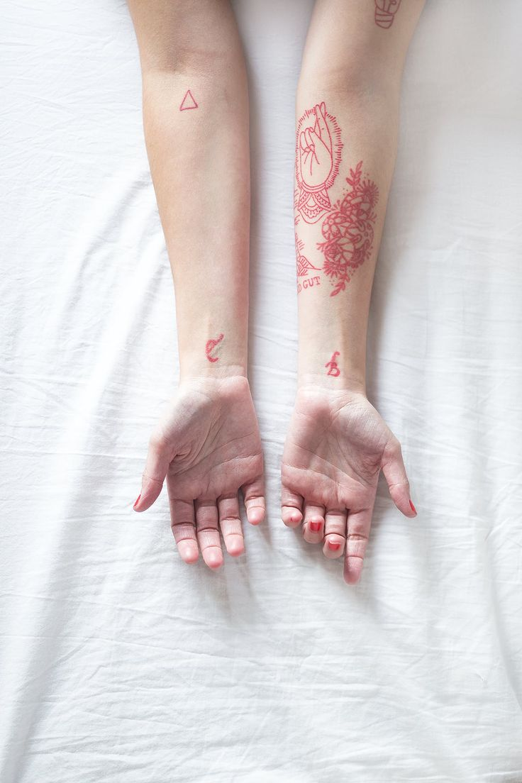 Red tattooes from Eva's arms; she has no fewer than eighteen to date. When asked why the red tattoos, she tells me that she is a huge fan of Brandon Boyd (from the band Incubus), who has some of his tattoos in red.