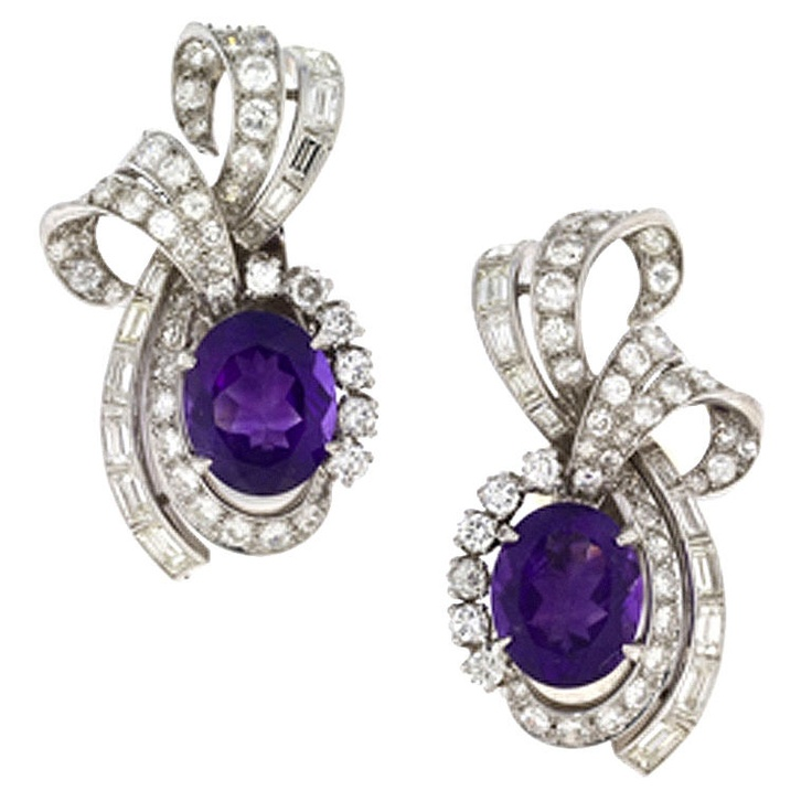 Amethyst Diamond Platinum Earrings Platinum earrings centering 1 four prong-set amethyst surrounded by diamonds and completed by clip backs. Total amethyst weight is approximately 3.85 carats each, total diamond weight for the pair is approximately 4.63 carats. Circa 1950s