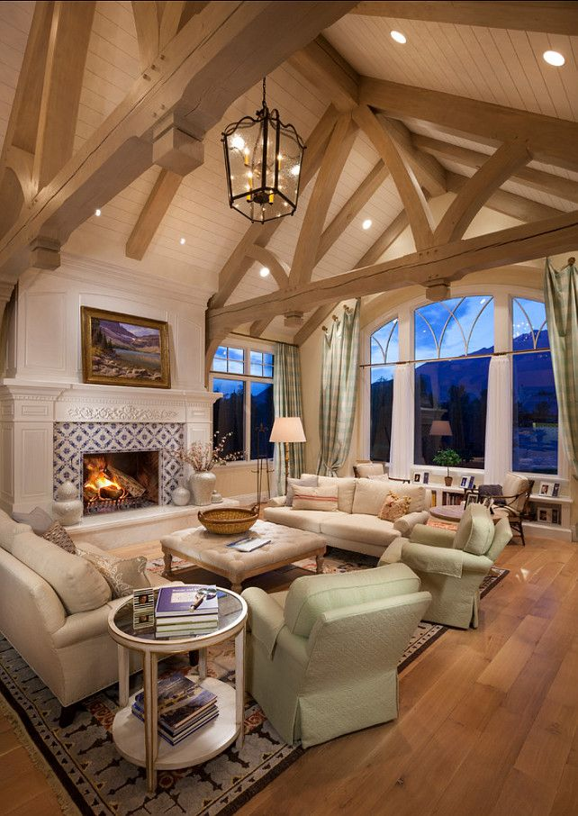 The wood rafters, hanging lantern light fixture, open seating area are excellent touches in this living room home decor.  The can lights look almost like stars in the ceiling.   CLICK ON PIN AND LEARN HOW TO MAP PINS WITH YOUR ARCHITECTURE BUSINESS
