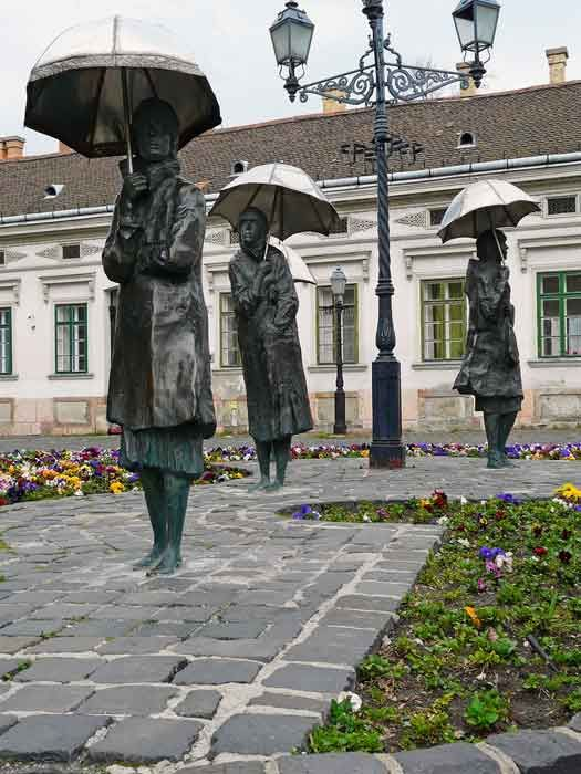 Women with umbrellas: bronze statues by Imre Varga in Obuda, Budapest, Hungary. Took pictures with these ladies :)